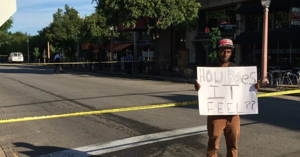 "At The Scene of STL Police Officer Ambush, Man Holds Sign That Says ""How Does It Feel??"""