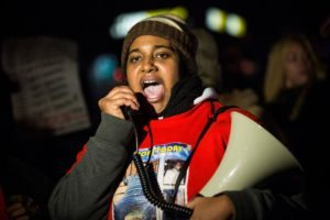 NEW YORK, NY - DECEMBER 11:  Erica Garner, daughter of Eric Garner,  leads a march of people protesting the Staten Island, New York grand jury's decision not to indict a police officer involved in the chokehold death of Eric Garner in July, on December 11, 2014 in the Staten Island Neighborhood of New York City. Protests have continued throughout the country since the Grand Jury's decision was announced last week.  (Photo by Andrew Burton/Getty Images)